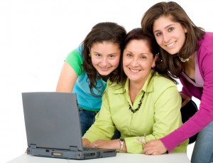 family on a laptop computer